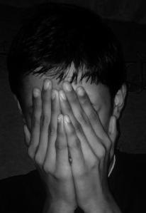 Hiding face in hands