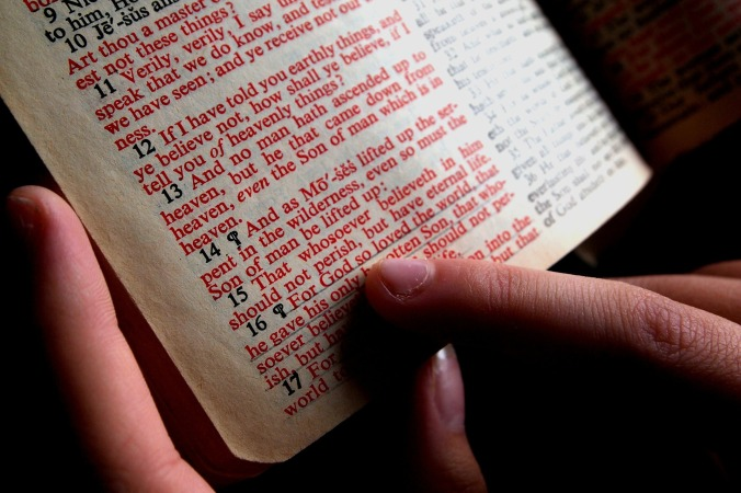 bible-close up with hand