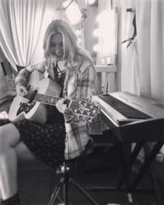 Brennley Brown black and white with guitar