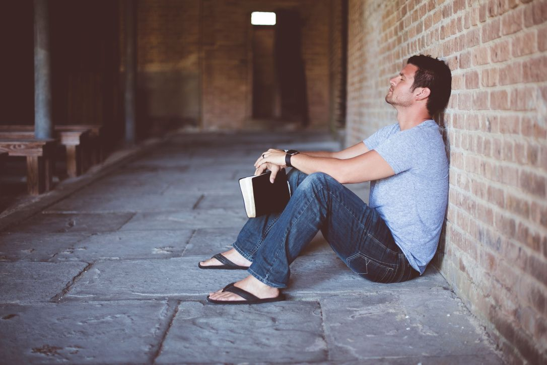 Depressed-guy-with-bible-compressor