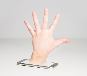 cell phone with hand coming out