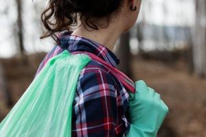 Trash bag over shoulder